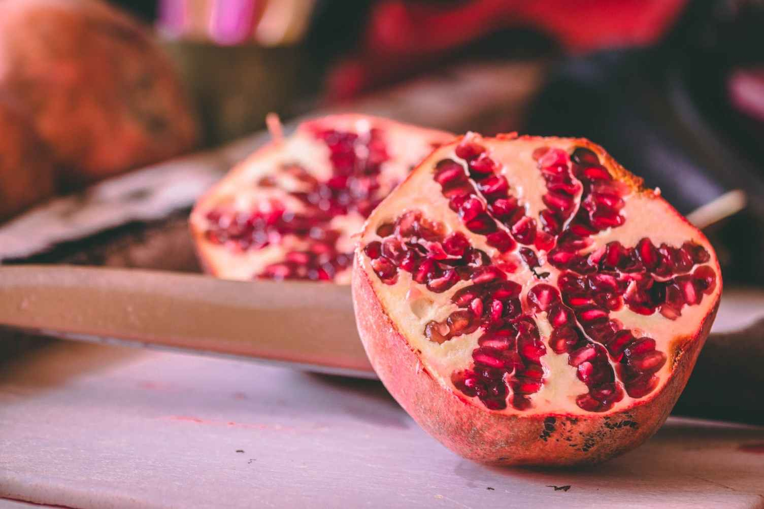 selective focus photography of sliced passion fruit
