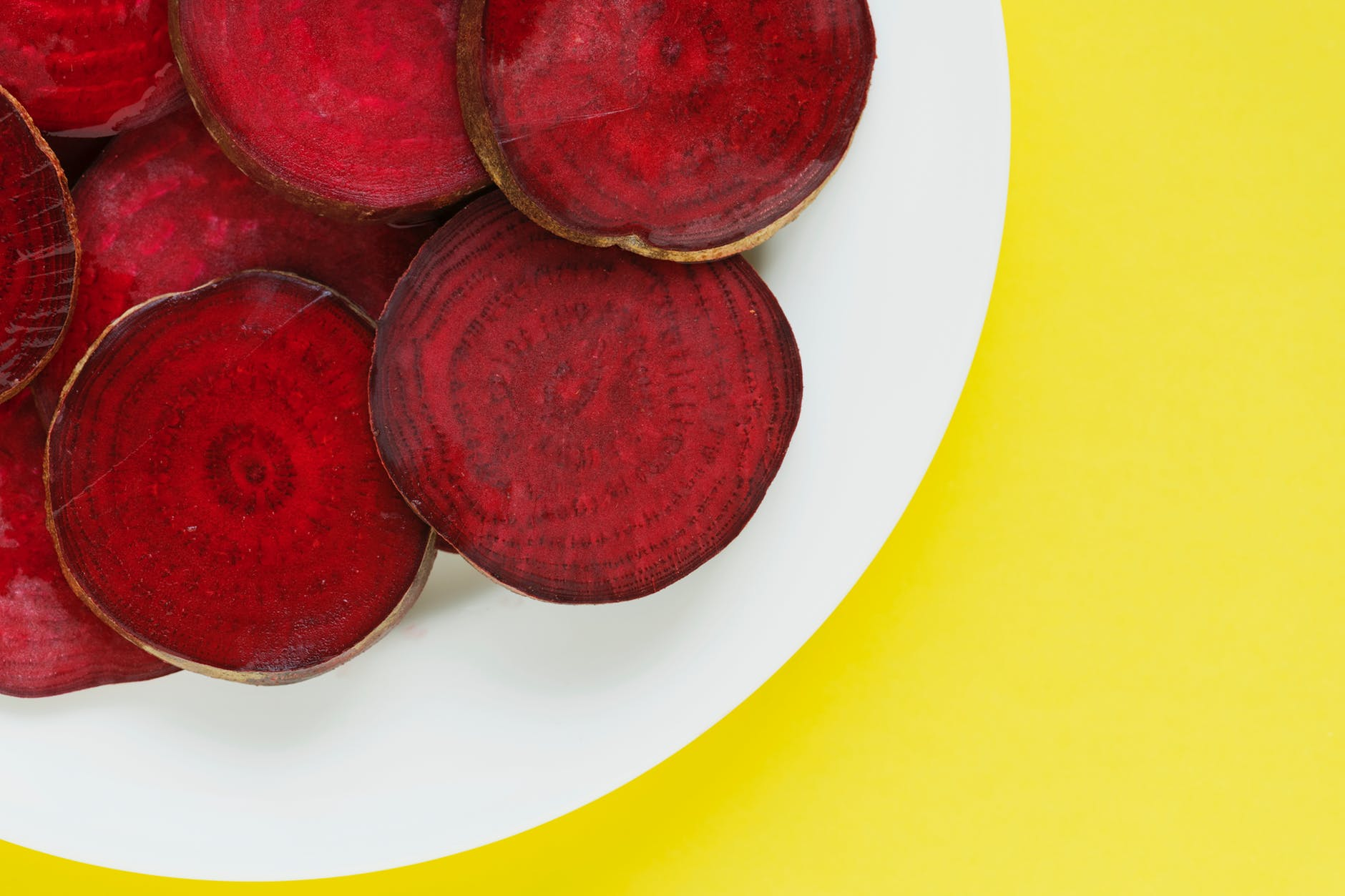 closeup photo of red beets on plate